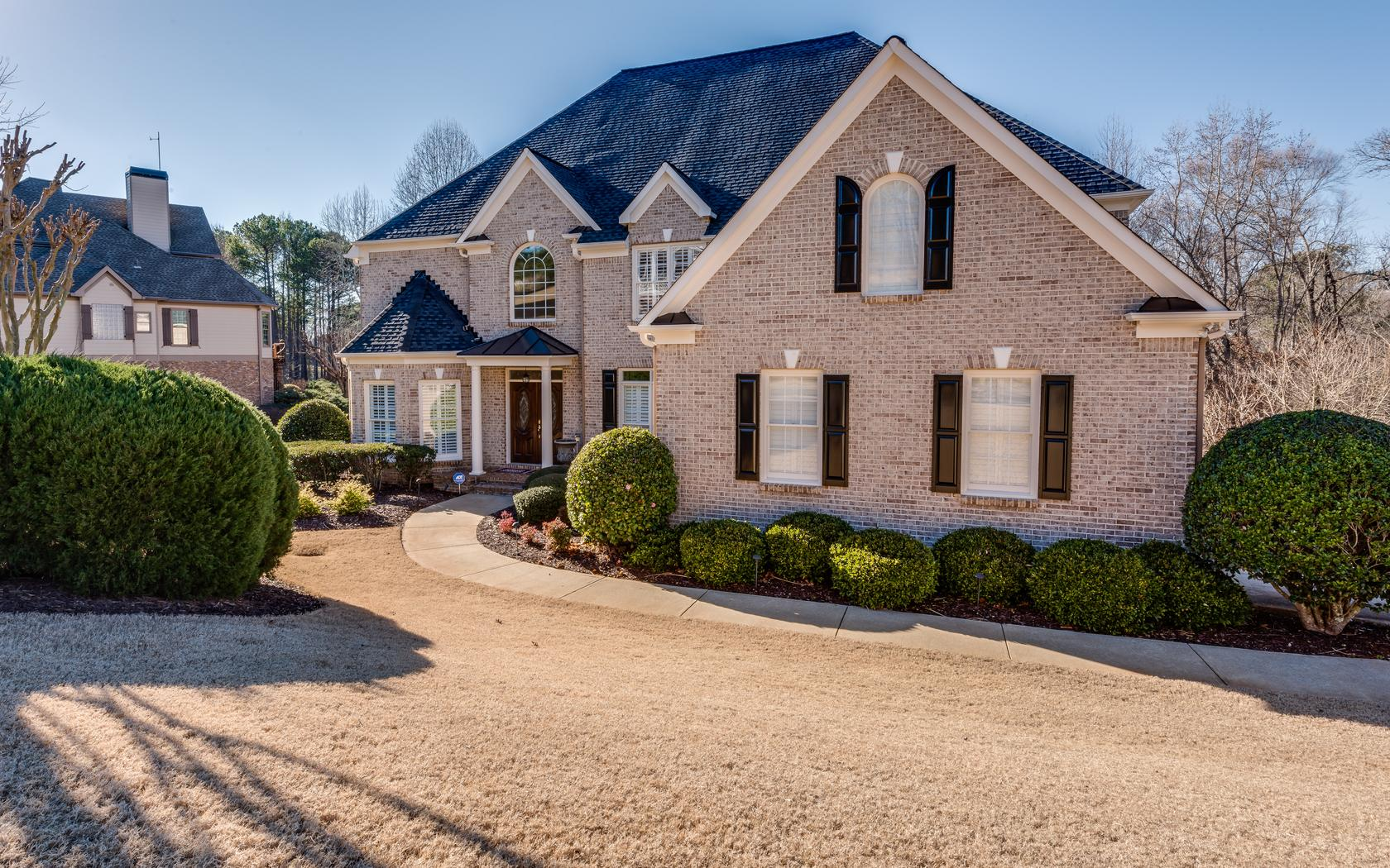 custom built brick home boasting golf course lot