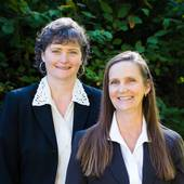"Becky Schertenleib, Nan Wimmers, ""sisters by chance, partners by choice"" (Columbia Gorge Real Estate)"