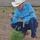 Kneeling with hat
