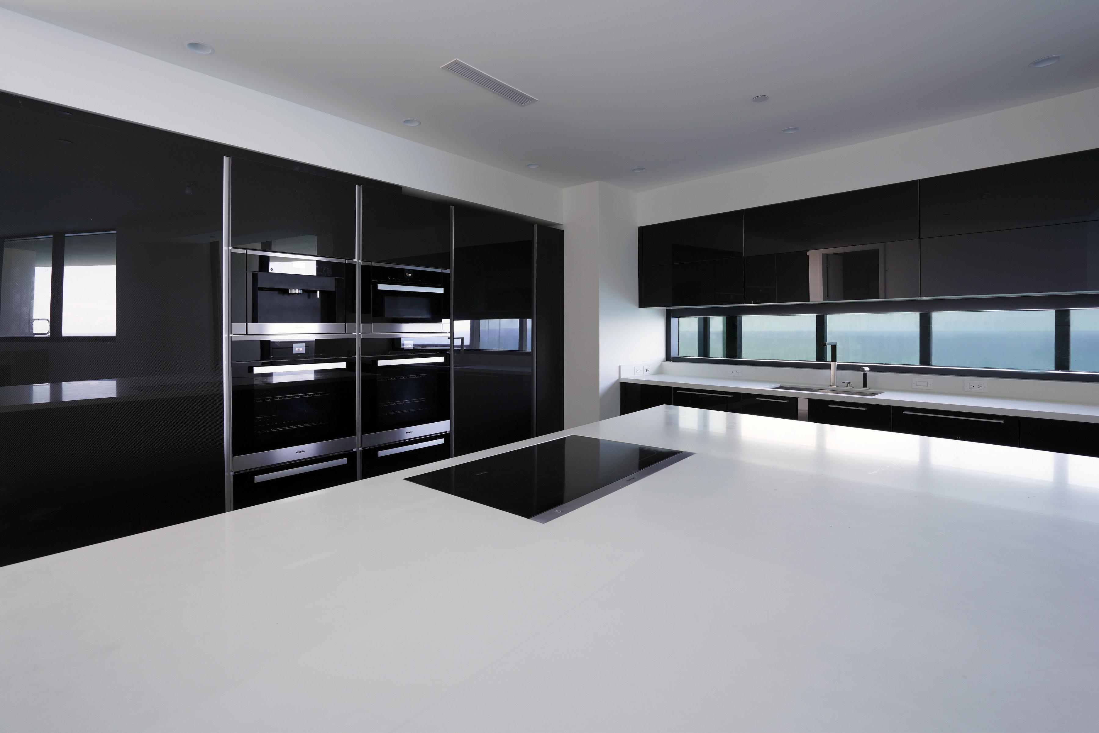 poggenpohl designed kitchen at porsche design tower. Black Bedroom Furniture Sets. Home Design Ideas