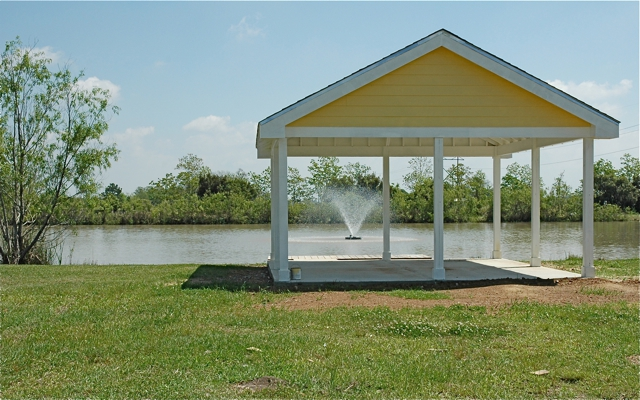 Chateau Vermilion Subdivision: Pond with picnic area and fishing pier
