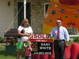 client with sold sign