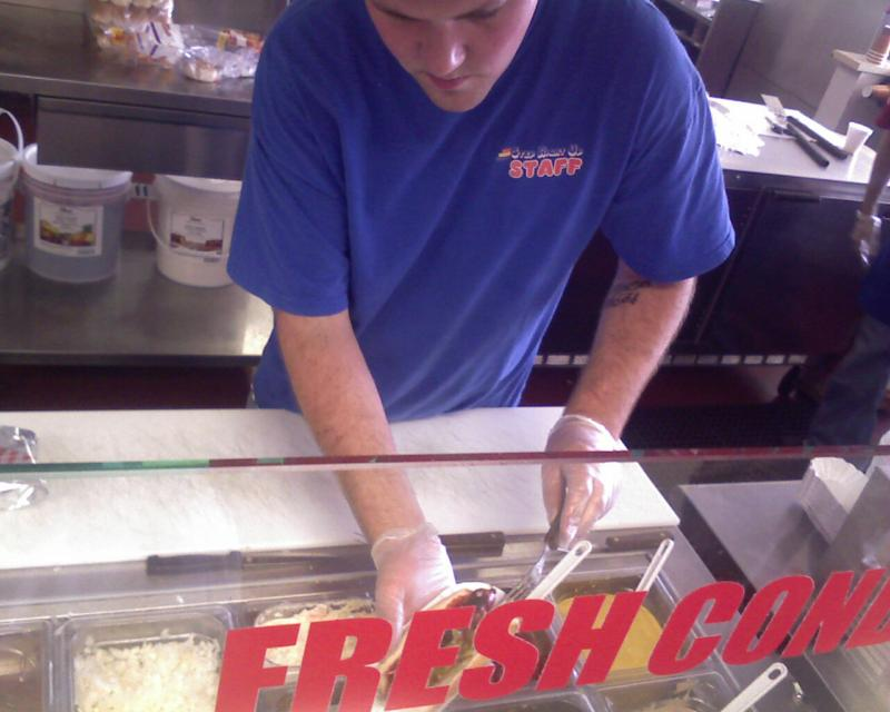Brian adds the toppings - many choices, just the way you like!