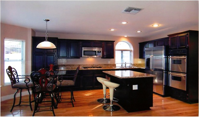 Refinished cabinets and granite countertops