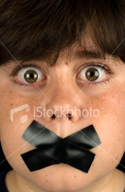boy with taped mouth