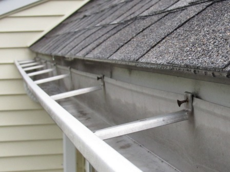 Dry wall screws used to fasten gutter to house