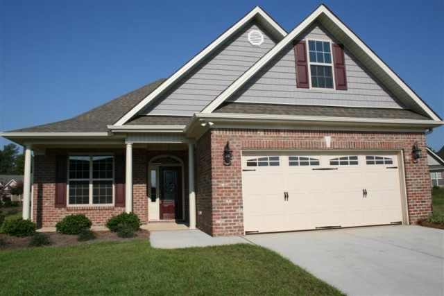 All Brick ranch with 2 car garage, covered porch