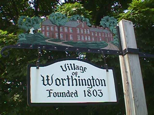 Old Worthington sign with trees