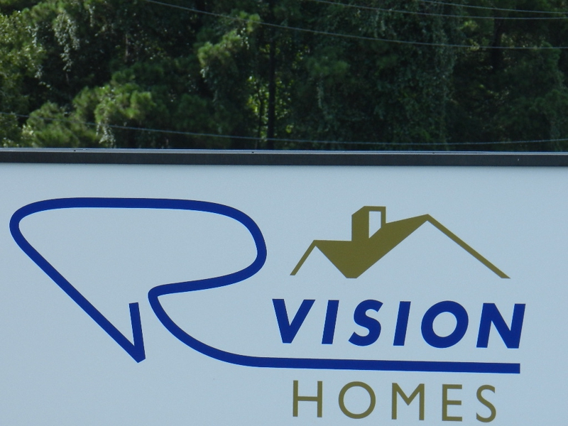 R Vision Homes sign