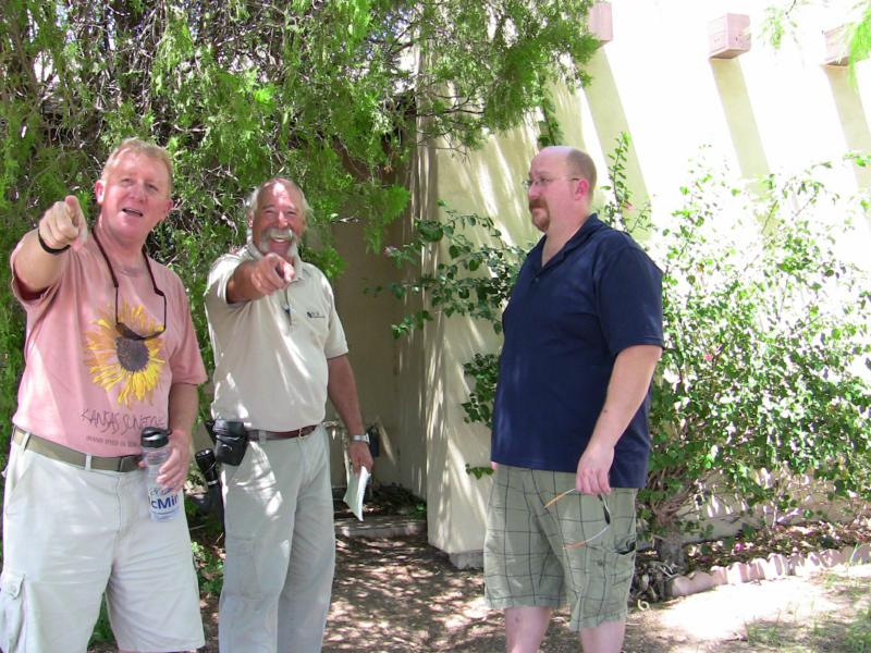 Tom (center) & his home inspection clients, laughing at the Banana Photog