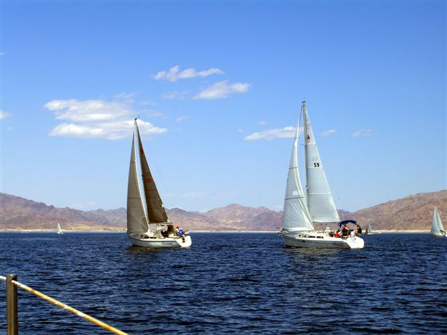 Two sailboats cruise the blue waters of Lake Mead on the second day of the