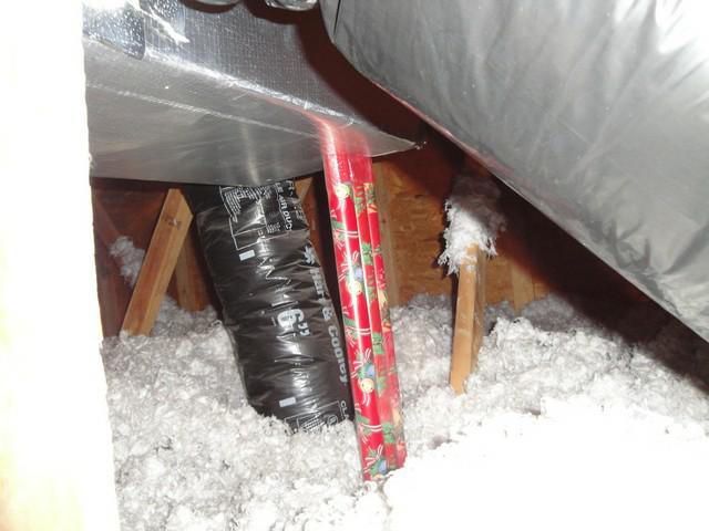 Erby - The Central Kentucky Home Inspector Chirstmas wrapping paper as duct support