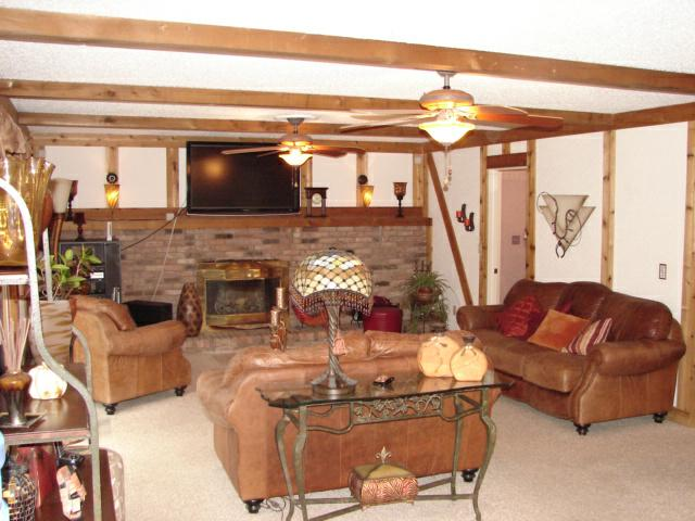 Family Room with Fireplace and leather furniture