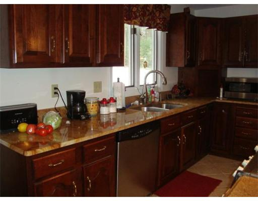 Another kathy stankard pending sale 27 forest lane for Brazilian cherry kitchen cabinets