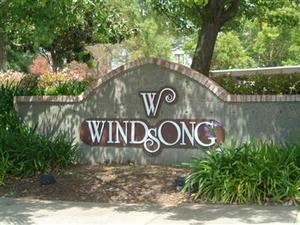 windsong condos sign, trees, blossoms