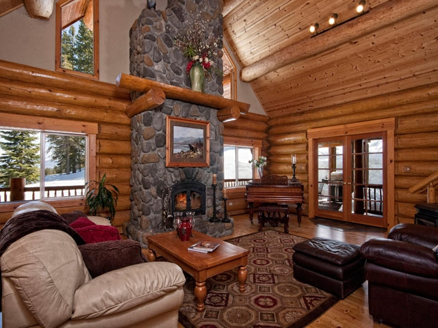 Great Room with stone to ceiling fireplace &mountain views
