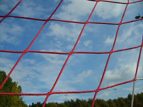 Soccer goal net up close.