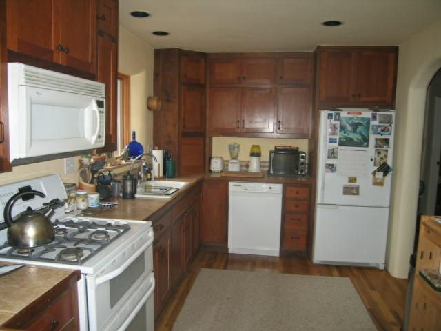 Walnut and Cherry custom kitchen cabinets