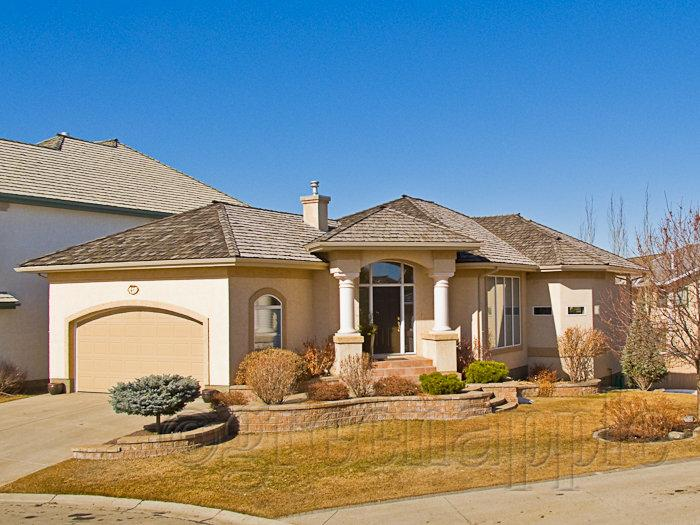 Exterior real estate photo of Calgary Home with processing