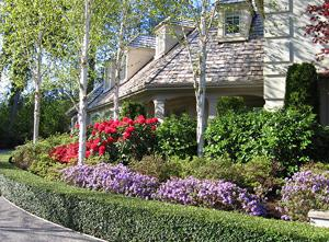 Photo of home with flowers in bloom - included in the Listing Sales Book