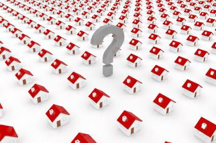 question mark surrounded by houses