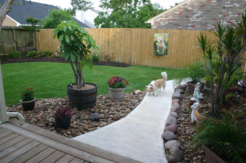 ... landscaping, dogkennel (not pictured), and French drain make your
