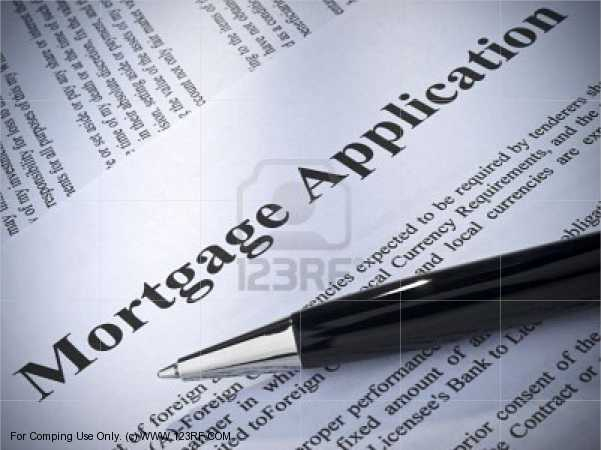 Mortgage loan application paperwork with black pen