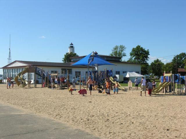 The Beach Was Packed With Sun Worshippers And Families Enjoying Beautiful Views Refreshing Ocean Breeze