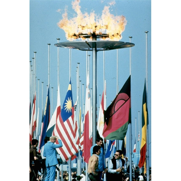Half mast world flags at the 1972 Olympic Flame