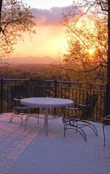 Snowy sunrise viewed from a deck overlooking Roanoke