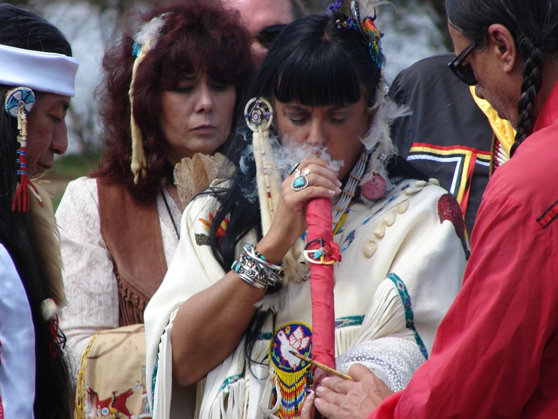 Bride Smoking Peace Pipe At Native American Wedding Ceremony