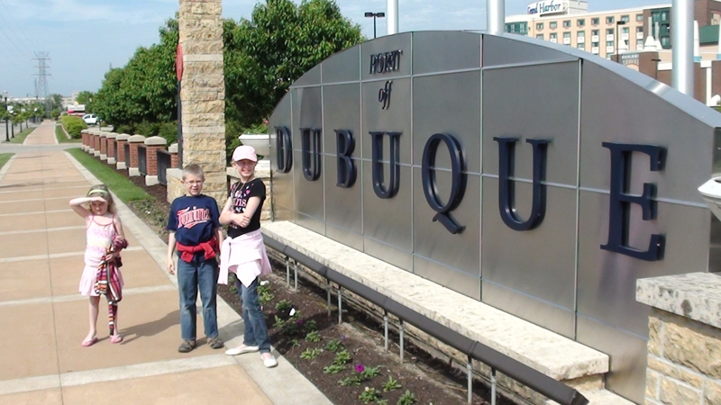 KIDS IN FRONT OF DUBUQUE SIGN