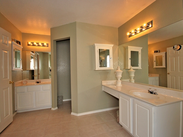 Master bath has double vanity and a walk-in closet