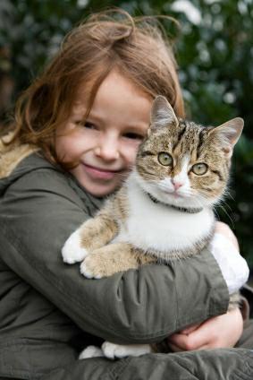 Girl and cat - istockphoto