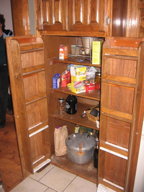 Cluttered and disorganized kitchen cabinet