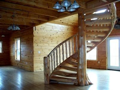 Amazing half log home near mount pleasant mi for Half spiral staircase