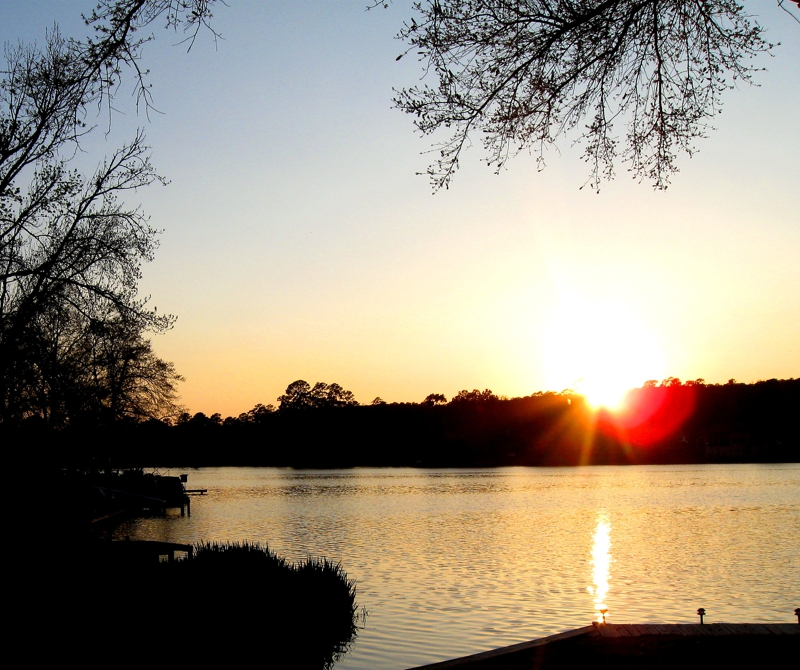Huntsville TX Real Estate, elkins lake sunset,mari montgomery realty,your elkins lake experts,real estate companies