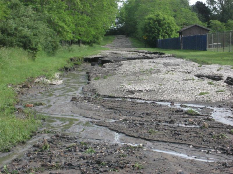 Road washed out by Manistee High School