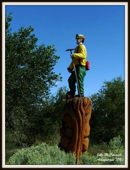 Carving of a Fireman in Bosque Forrest
