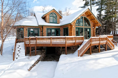 Full log executive home bay lake for Alaska cabin builders