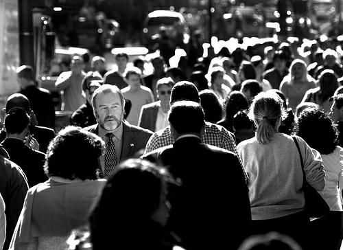 A face stands out in a crowd of people.