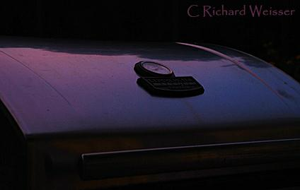 Dawn reflected on the grill by Richard Weisser
