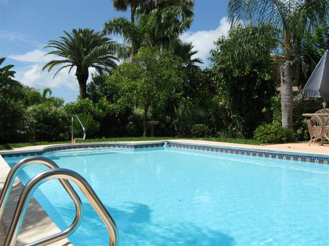 huge pool with home in treasure island florida