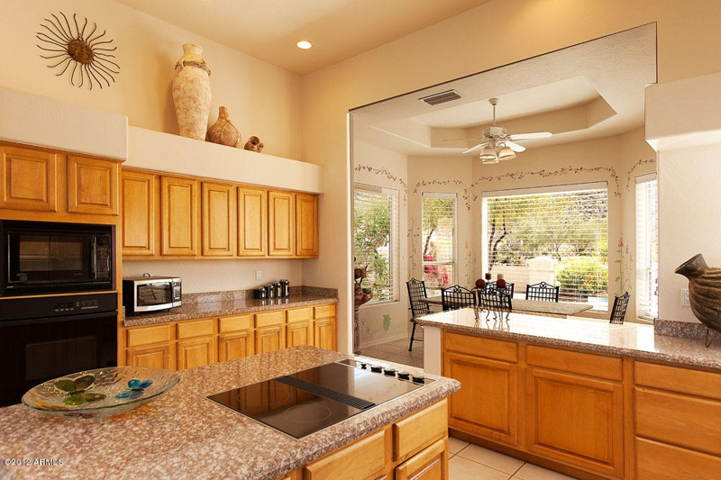 kitchen with granite countertop in 6 bedroom Phoenix homes for sale. Stunning Phoenix Az houses for sale on one acre of land close to