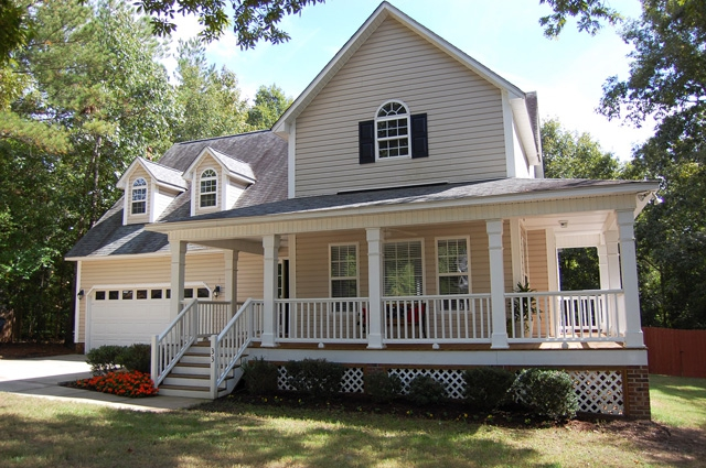 country home with a wrap around front porch