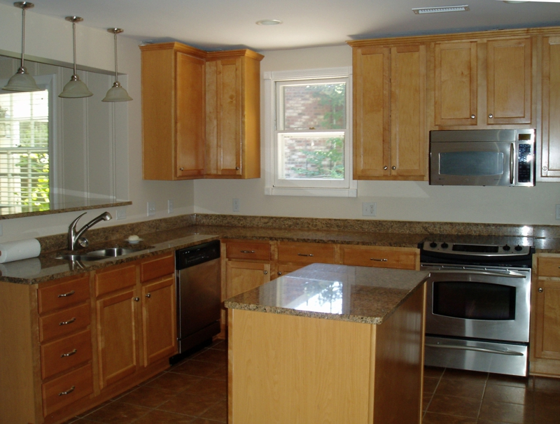 A plain-Jane kitchen which could use some staging.