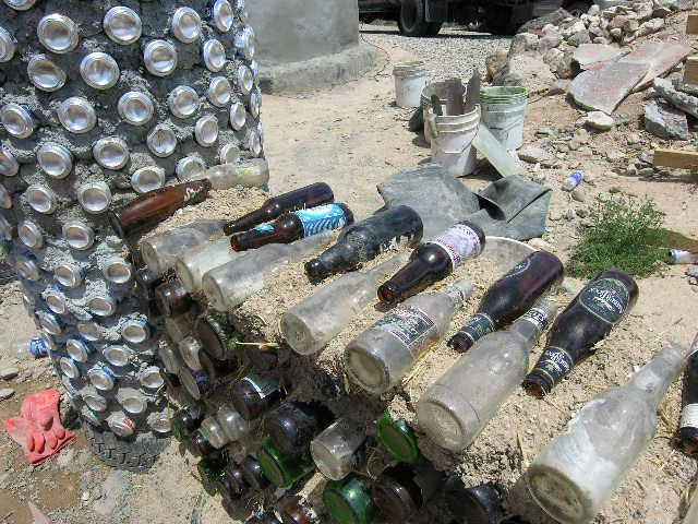 Bottles and cans in Earthship Construcion