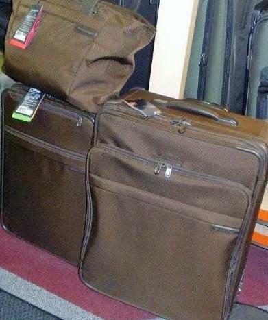 Brown luggage HomeRome.com