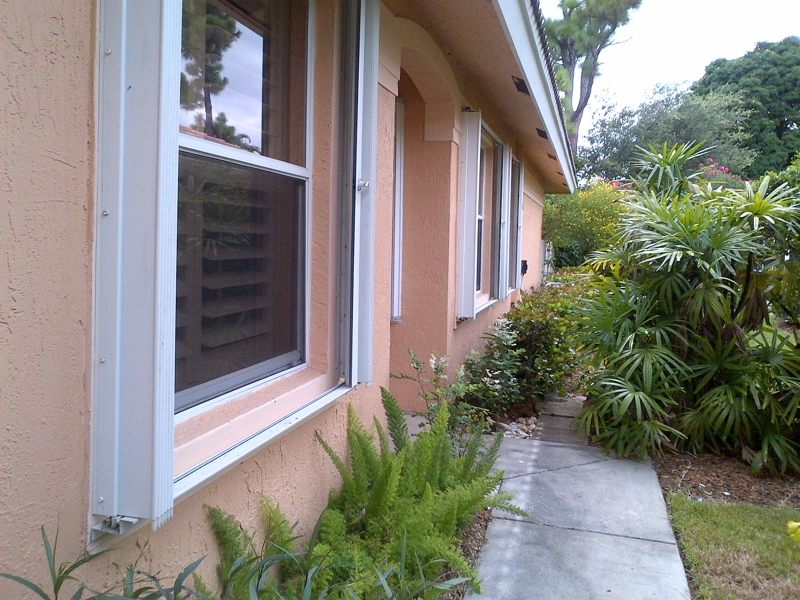 Accordian Shutters & Plantation Shutters Throughout