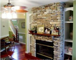 View Of Stone Fireplace In Greatroom